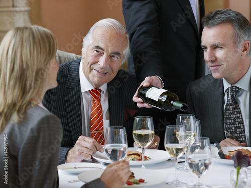 business people talking. Three usiness people talking