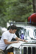 Man observing map on car bonnet
