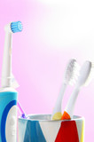 assorted tooth brushes, an  electric and regular poster