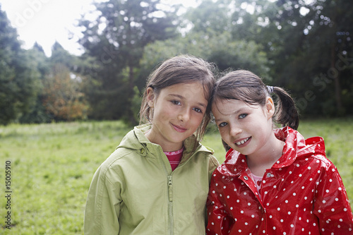 Portrait of two girls 7-9 in raincoats