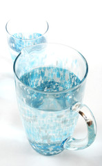 Stock photo of a pitcher and glass