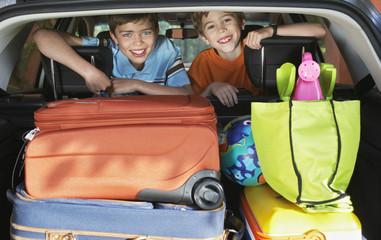 Portrait of boys 6-11 in loaded car