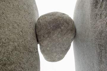 Rock wedged between two boulders