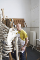 Male artist painting in studio