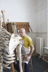 Male artist painting in studio