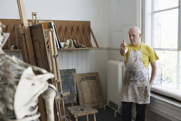 Artist studying skeleton in studio