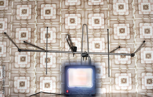 Old fashioned tv set with antenna, wallpaper with pattern