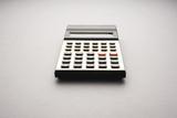 Old fashioned calculator on white background, studio shot