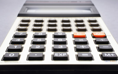 Close-up of old calculator, selective focus