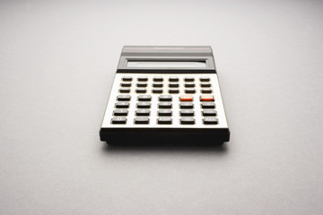 Old fashioned calculator on white background, studio shot
