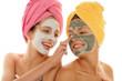 Leinwanddruck Bild - Two teenage girl applying facial cream