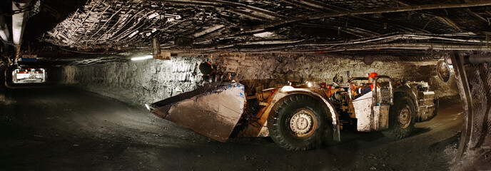 Person in unconventional car in tunnel, side view