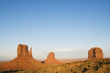 monument valley during the day with blue sky.