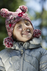 Portrait of girl 5-6 in winter clothes, smiling
