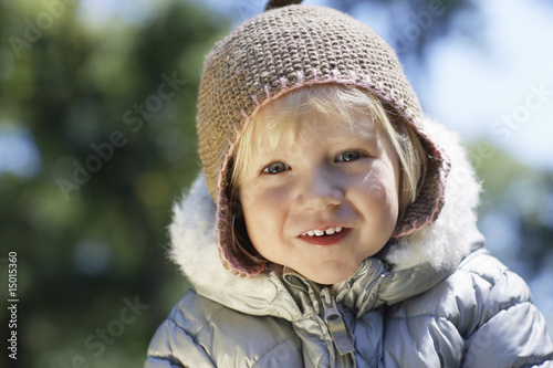 Portrait of young girl 3-4 in winter clothes, outdoors