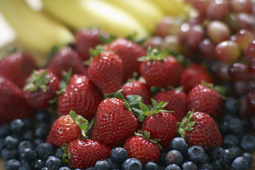 Blackberries, strawberries, grapes and bananas, close-up, selective focus