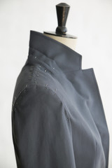 Mannequin with unfinished jacket , close up, side view