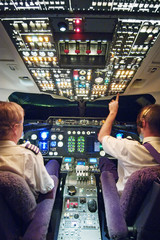Two pilots in aeroplane cockpit