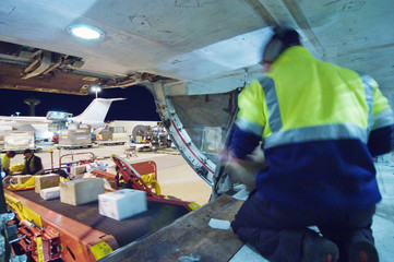 Loading freight into cargo hold of aircraft