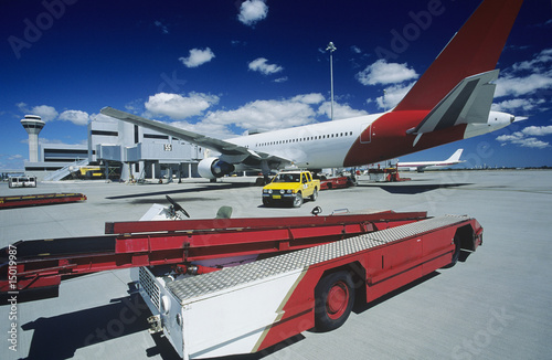 Cart near aeroplane at airport, Perth, Australia
