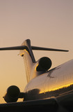 Tail fin of airplane, sunse