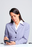 Businesswoman using a smartphone poster