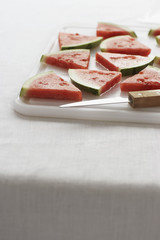 Watermelon slices on chopping board, close-up