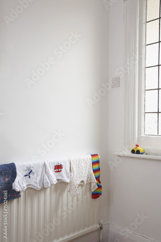 Child's clothing drying on radiator