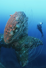Bikini Atoll, Marshall Islands, Pacific Ocean, scuba diver swimming near propeller of sunken battleship HIJMS Nagato