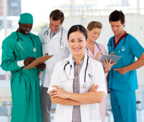 Attractive female doctor with her team