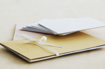 Envelopes and paper stationery, elevated view, close up, studio shot