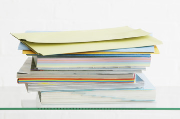 Stack of coloured stationery, studio shot