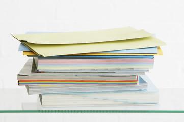 Stack of coloured stationery, studio shot