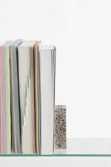 Paper stationery on glass shelf, studio shot