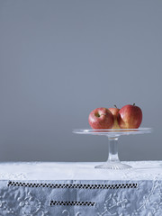 Three apples on fruit platter on table