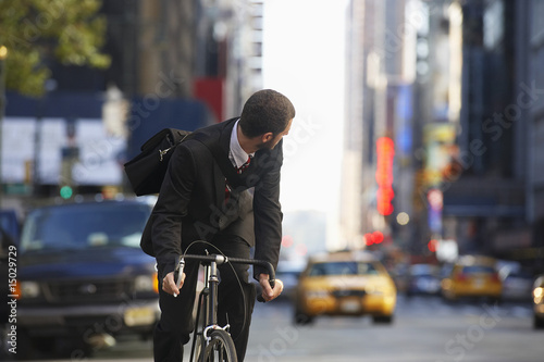 Man riding bicycle on street