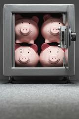 Four piggy banks in safe