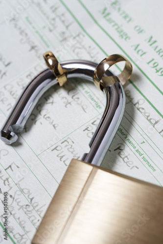 Padlock with two wedding rings on marriage act, close-up