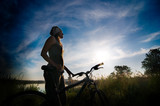 girl biking at sunrise