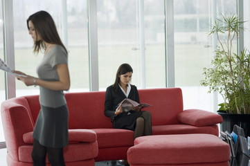 Professional women in waiting area