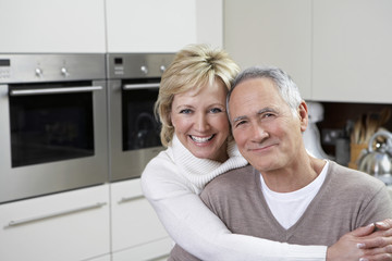 Portrait of middle-aged couple in kitchen