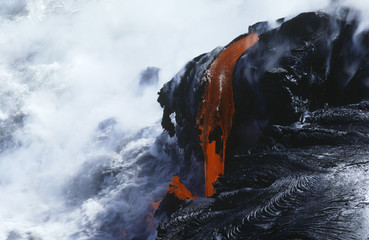USA, Hawaii, Big Island, Volcanos National Park, cooling lava and surf