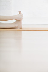 teenage girl (16-17) stretching leg low section