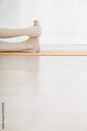 teenage girl (16-17) stretching leg low section