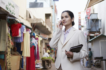 business woman using cell phone on bazaar