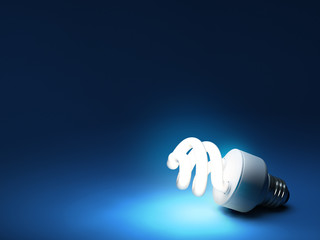 Compact fluorescent bulb - resting on blue background