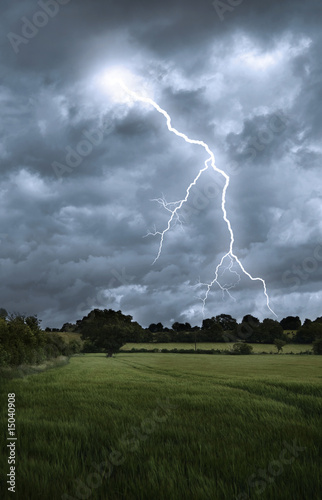 Lightening strike over field landscape
