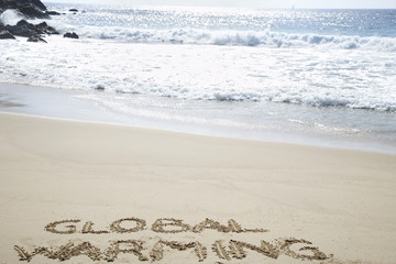 Global warming text written in beach, elevated view