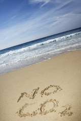 No CO2 text written on beach, elevated view