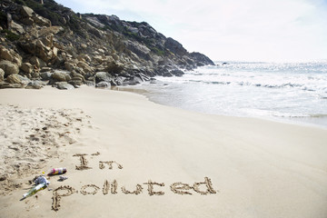 I'm polluted text written on beach, elevated view